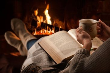 woman_sipping_chocolate_reading_book_fireplace.jpg.653x0_q80_crop-smart